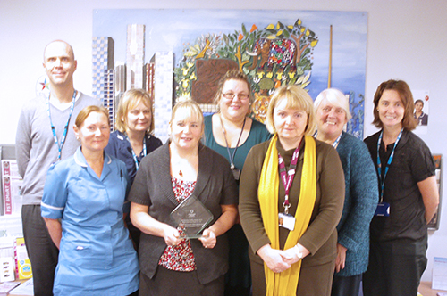 Advancing Qulity leads from the Trust photographed with the award