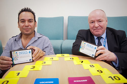Robin Jamil (left) and Kevin Scallon (right) with the 'Getting on with people' board game