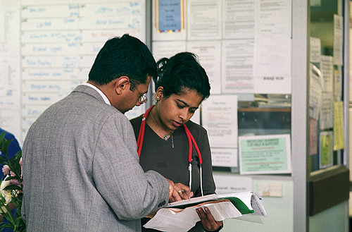 Two doctors discussing a patient's notes