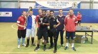 Regent FC celebrating their league victory in Blackburn Rovers Football Club's indoor training centre